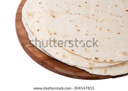 Mexican tortillas on a kitchen wooden board.