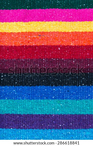 Mexican traditional rustic rug with stripes and bright colors background. - stock photo