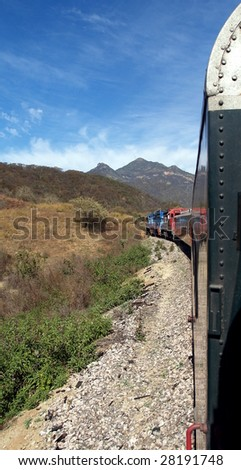 Mexican train on the coastal plain as it move eastwards towards the Copper Canyon and begins climbing 6500' in a matter of 150 miles - stock photo
