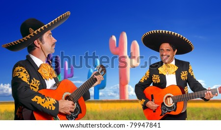 Mexican two mariachis with charro costume singing playing guitar in cactus Mexico [Photo Illustration] - stock photo