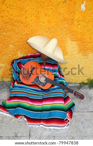 Mexican typical lazy sombrero man having nap siesta sitting in floor - stock photo