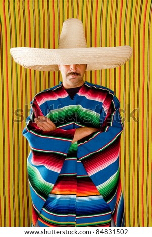Mexican typical poncho man with sombrero and mustache over yellow background - stock photo