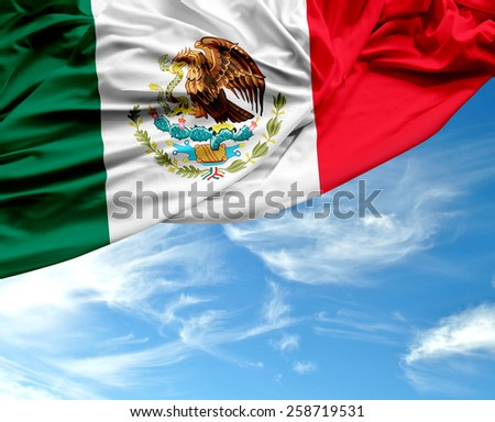 Mexican waving flag on a beautiful day - stock photo