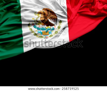 Mexican waving flag on black background - stock photo