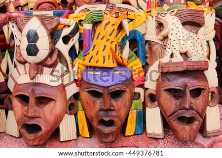 Mexican wooden carved masks - stock photo