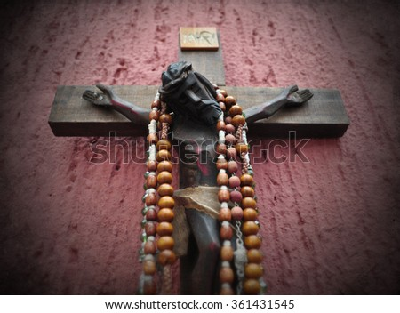 Mexican wooden crucifix with vignette  - stock photo