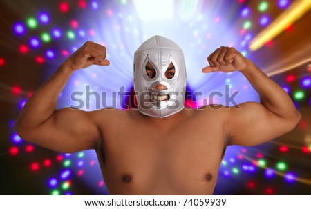 mexican wrestling mask silver fighter gesture night lights blurred [Photo Illustration]