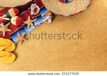 Mexico beach background : Mexican beach background with sombrero straw hat, traditional serape blanket, starfish, seashells and maracas.  Space for copy in sand.   Horizontal format. - stock photo