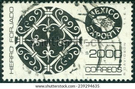 MEXICO - CIRCA 1975: A stamp printed in Mexico shows filigree ironwork with the words Hierro Forjado Mexico Exporta, circa 1975. - stock photo