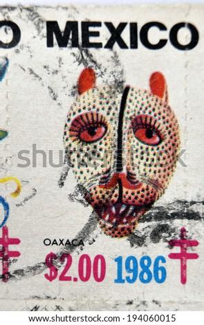 MEXICO - CIRCA 1986: A stamp printed in Mexico shows Mexican mask, oaxaca, circa 1986 - stock photo