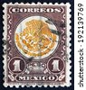 MEXICO - CIRCA 1934: a stamp printed in the Mexico shows Coat of Arms of Mexico, Golden Eagle and Snake, circa 1934 - stock photo