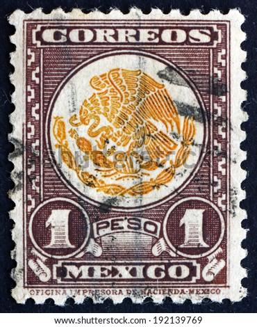 MEXICO - CIRCA 1934: a stamp printed in the Mexico shows Coat of Arms of Mexico, Golden Eagle and Snake, circa 1934 - stock photo