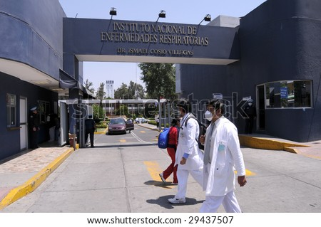 MEXICO CITY - APRIL 28: Hospital workers walk past the main entrance of the Mexican Institute of Respiratory Illnesses on April 28, 2009 in Mexico City. Concern over the Swine Flu spreads worldwide. - stock photo