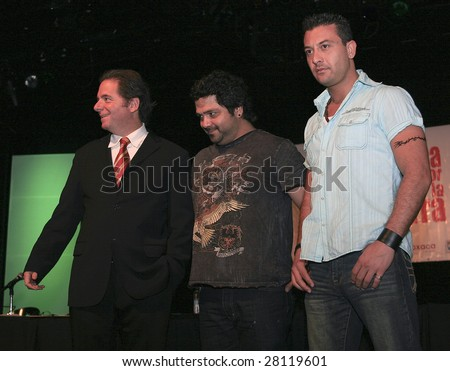 MEXICO CITY - APRIL 6: (L-R) Mr. Agustin Pumarejo, Iguana and Javier attend Festival Music for the Earth Music Fest press conference at El Lunario Concert Hall April 6, 2009 in Mexico City, Mexico. - stock photo