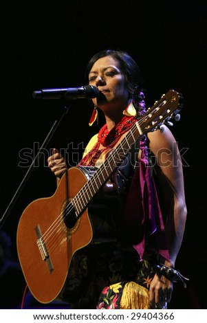 MEXICO CITY - APRIL 21 : Singer Lila Downs performs during the Chavela Vargas 90th Anniversary homage at the Teatro de La Ciudad de Mexico on April 21, 2009 in Mexico City, Mexico. - stock photo
