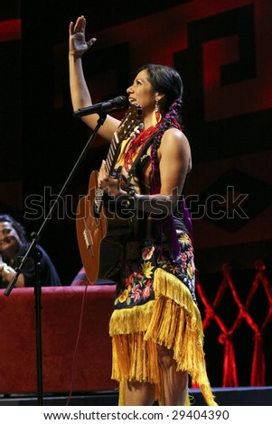 MEXICO CITY - APRIL 21 :  Singer Lila Downs  performs during the Chavela Vargas 90th Anniversary homage at the Teatro de La Ciudad de Mexico on April 21, 2009 in Mexico City, Mexico. - stock photo