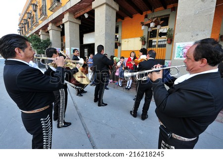 MEXICO CITY - FEB 24 2010 :Mariachi band play mexican music in Garibaldi Square in Mexico City, Mexico.The Plaza is best known as the Mexico City home of mariachi music. - stock photo