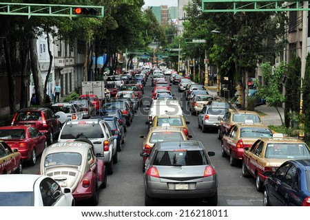 MEXICO CITY - FEB 24 2010:Traffic congestion in Mexico City.In 2012, there were 23,550,000 registered motor vehicles in Mexico.It's estimated that by 2018 there will be more than 35,495,000 vehicles. - stock photo
