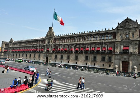 MEXICO CITY - FEB 24 2010:Visitors outside the Mexico National Palace.Its a famous landmark and one of the oldest buildings in Mexico City, Mexico. - stock photo