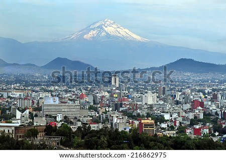 MEXICO CITY - MAR 01 2010:Popocatepetl volcano mountain raise above Mexico city.It's the most active volcano in Mexico with more than 15 major eruptions since the arrival of the Spanish in 1519.  - stock photo