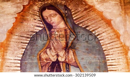 MEXICO CITY, MEXICO-DECEMBER 25, 2015 Original Virgin Mary Guadalupe Painting which was revealed by Indian Peasant Juan Diego 1531 to Catholic Bishop. New Shrine of the Guadalupe, Mexico City Mexico - stock photo