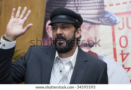 "MEXICO CITY, MEXICO- JULY 31: Singer Juan Luis Guerra attends His Latest  World Wide Tour ""La Travesia (THe Journey),"" press conference at Camino Real Hotel July 31, 2009, in Mexico, City, Mexico. - stock photo"