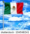Mexico flag against blue sky - stock photo