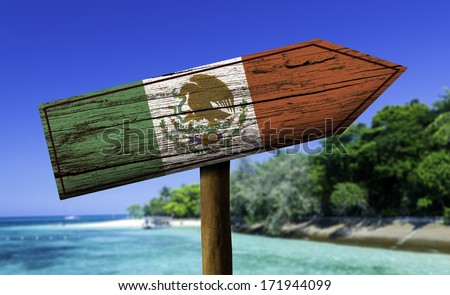 Mexico flag wooden sign with a beach on background - Central America - stock photo