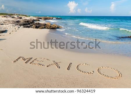 Mexico sign on the beach of Caribbean Sea - stock photo