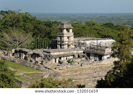 Mexico, The ancient city of Palenque sits like a king on a throne of jungle where plains meet mountains. The picture presents general view of the palace complex