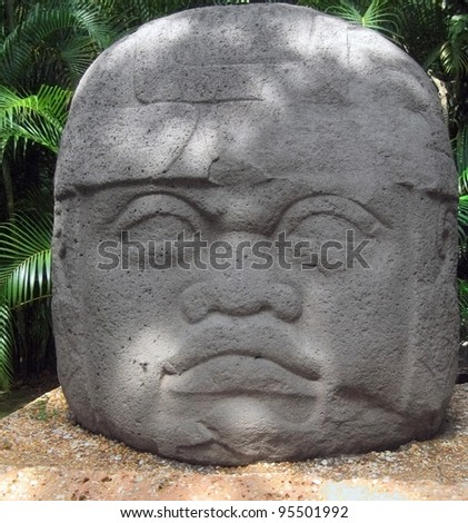 Mexico, Villahermosa, gigantic 20 tons basalt Olmec head, in La Venta park museum. Under the canopies of the rain forest, the mysterious Olmec developed the oldest of all Meso-American civilizations - stock photo