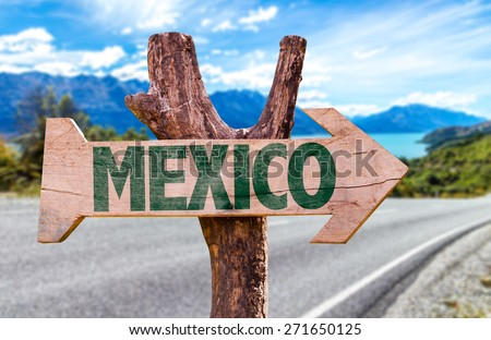 Mexico wooden sign with road background - stock photo