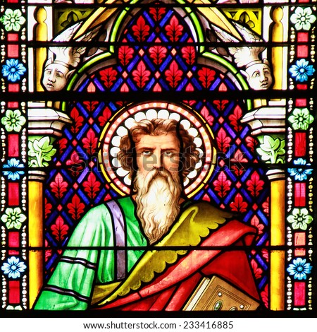 MEZE, FRANCE -July 23, 2014: Apostle. Stained glass window in the Cathedral of Meze, South of France - stock photo