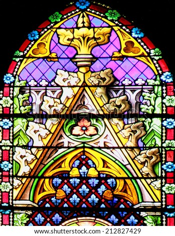MEZE, FRANCE - July 23, 2014: Colourful seamless stained glass window panel in the Cathedral of Meze, on July 23, 2014 in Meze, south of France - stock photo