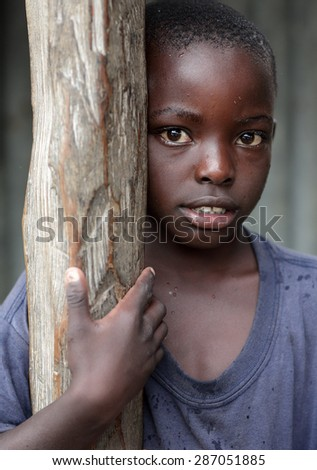 MFANGANO ISLAND - KENYA - DECEMBER 25, 2014: Unidentified orphan in an orphan boarding school on December 25, 2014 on Mfangano Island, Kenya. Many children lost their parents because they died of HIV. - stock photo