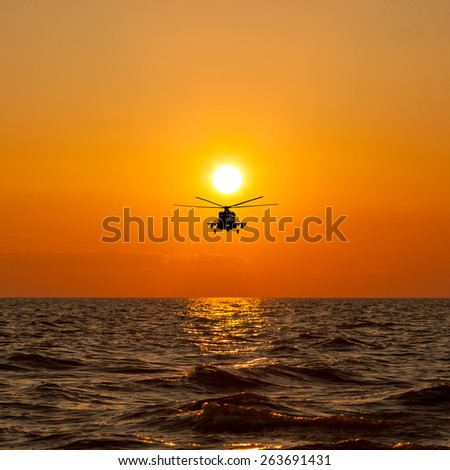 Mi-8 helicopters, warm sunset - stock photo