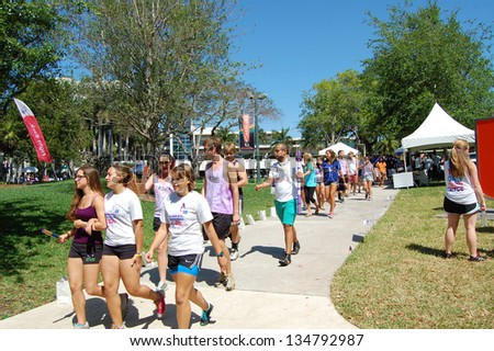 MIAMI - APRIL 6: Students participate in the American Cancer Society Relay for Life event on the University of Miami campus in Coral Gables, Florida on April 6, 2013.