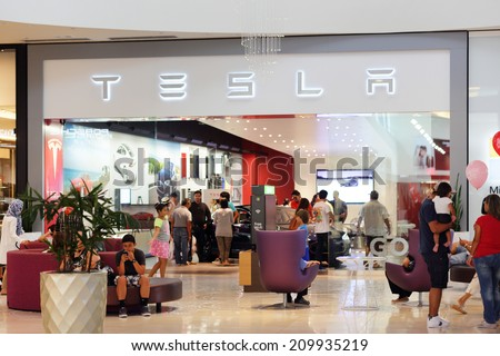 MIAMI - AUGUST 4: Stock image of the Tesla store at Dadeland Mall Miami taken on August 4, 2014 in Miami FL.  - stock photo