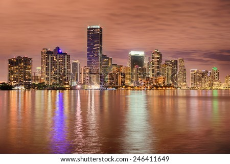 Miami bayfront skyline at night with actual reflections in water - stock photo