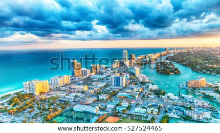 Miami Beach buildings and canals, aerial sunset view.