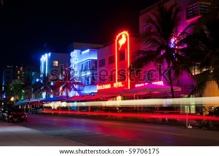 MIAMI BEACH - CIRCA JULY 2009: Night view at Ocean drive circa July 2009 in Miami Beach, Florida. Art Deco Night-Life in South Beach is one of the main tourist attractions in Miami. - stock photo