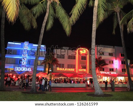 MIAMI BEACH - DECEMBER 29: Ocean Drive, the center of the Miami Art Deco District, which is home to about 800 preserved buildings and famous for nightlife.Shot on December 29, 2012 in Miami Beach, USA - stock photo