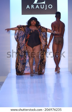 MIAMI BEACH, FL - JULY 21: Brazilian actress Priscilla Marinho walks the runway at the A.Z Araujo show during Mercedes-Benz Fashion Week Swim 2015 on July 21, 2014 in Miami Beach, Florida. - stock photo