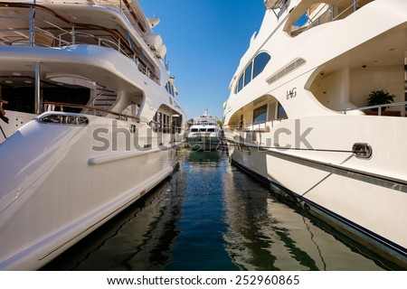 Miami Beach, Fl USA - February 13, 2015: The popular Miami International Boat Show features more than 3,000 boats and 2,000 exhibitors from all over the globe. - stock photo