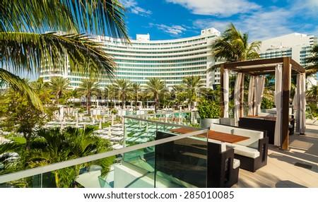 Miami Beach, FL USA - October 3, 2012: The beautiful pool area of the historic art deco Fontainebleau Hotel on Miami Beach. - stock photo