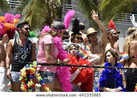 MIAMI BEACH, FLORIDA, APRIL 9, 2016: The 8th Annual Miami Gay Pride, Ocean Drive in Miami Beach, Florida. Lesbian, gay, bi, transgender celebrate. Happy people on the transporter.