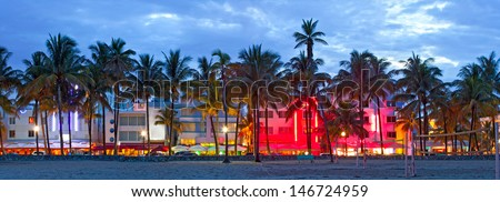Miami Beach, Florida  hotels and restaurants at sunset on Ocean Drive, world famous destination for it's nightlife, beautiful weather, Art Deco architecture and pristine beaches - stock photo