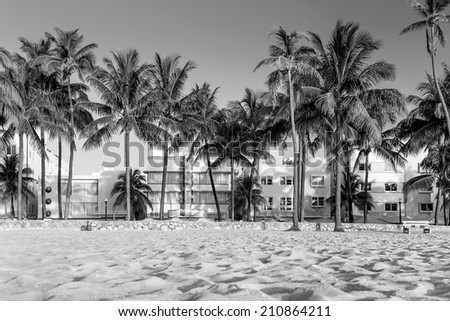 Miami Beach, Florida hotels and restaurants on Ocean Drive. World famous destination for it's nightlife, beautiful weather and pristine beaches black, white - stock photo