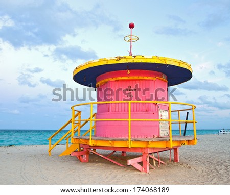 Miami Beach Florida, purple Art deco lifeguard house on a beautiful summer afternoon with ocean in the background - stock photo