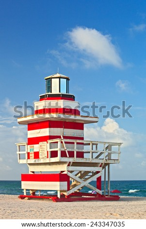 Miami Beach Florida, red and white Art deco lifeguard house on a beautiful summer day with blue sky in the background  - stock photo